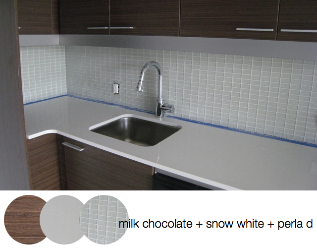 Central Condominiums Kitchen dark cabinet white glass backsplash white counter interior design